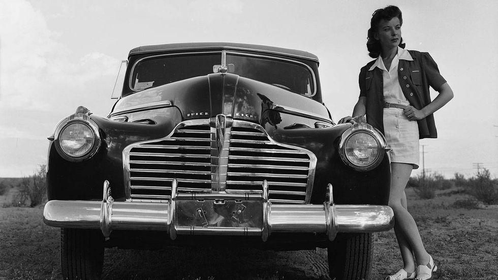 Circa 1935: British leading lady Ida Lupino (1918-1995) daughter of the renowned British actor, Stanley Lupino, standing by a Buick Super.