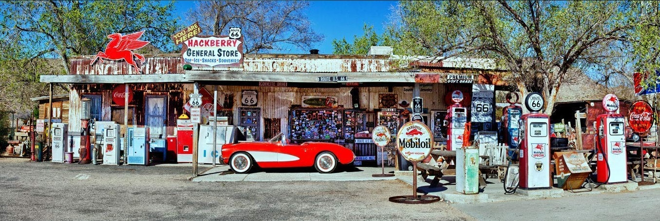 Red Vintage Corvette and Gas Station Pumps on Rt66 in Hackberry, Arizona.
