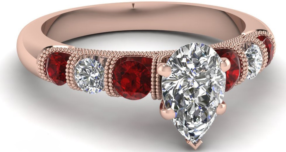 A Magnificent GIA 1 Carat Pear Conflict Free Diamond And Ruby Unique Milgrain Engagement Ring